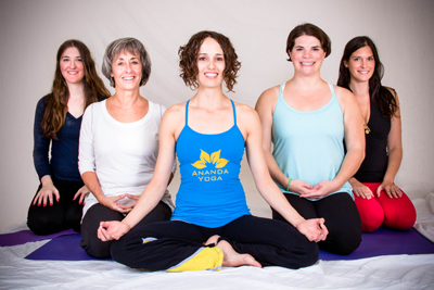 Ananda teachers in hero pose and easy pose.