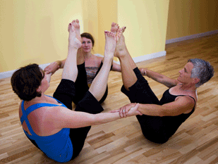 Michele, Chris and Bobbi in Navasana.